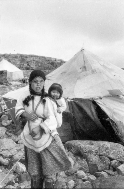 1215-photo-Young-Inuit-girl-carrying-a-baby-in-her-amauti-hood_g